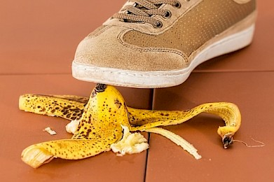 Shoe about to step on a banana peel