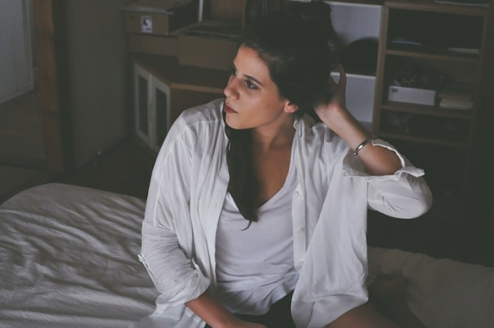 How to stop coughing - woman sitting on bed